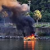 Convertible explodes and catches fire in the ocean after getting stuck in a mudflat